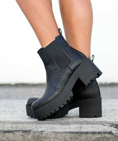 Lipstik Eamon Chunky Pull Tab Black Boots - These chunky-style boots feature elastic sides with a back pull tab and thick heel and sole with rubber teeth detailing. $90.00