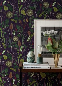 Skörd | dark purple | A wallpaper from Tigron & Floyd | Skörd is a wallpaper inspired by the cultivator Amanda Hellberg's plot of vegetables. The pattern consists of beetroots, potatoes, artichoke and leaves from the dandelion. The background is dark purple.