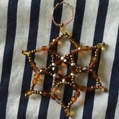 Tutorial on how to make a beaded star - basic. Working from this, you can branch out to create your own, freely modifying the process to match your needs and tastes.