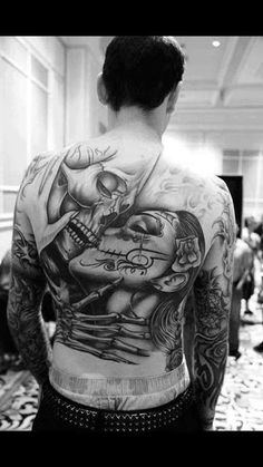 Sugar Skulls tattoo on back