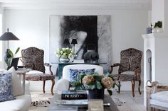 glam-zebra-dining-chairs-eclectic-modern-house-blue-and-white-artwork-and-furniture-arrangement-ideas-coffee-table-decor-design