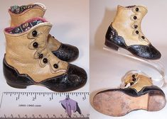 """Child's boots, 1870. They are two tone, made of a tan leather upper boot and black patent leather lower shoe with decorative cut work stitching and scalloped edge top, sides. The boots have five black shoe buttons for closure, rounded toes, hard leather soles and stacked wooden low cube heels. They are lined in pink leather. The boots measure 4"""" tall, 5.5"""" long, 2"""" wide, with a 1/2 high heel."""