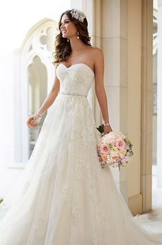 This vintage inspired tulle A-line wedding dress with diamante-embellished lace is so pretty.