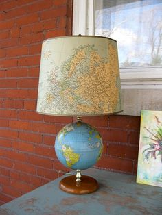 recover a lamp shade with a map - good idea!
