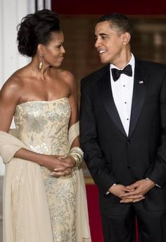 The first lady and president gaze into each other's eyes before a state dinner, the Obamas' first, at the White House, Nov. 24, 2009.