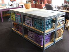 You can store a lot of fabric and sewing essentials on this take. It's made with four short steel shelve units