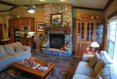 Traditional Living Room with slate tile floors, Ceiling fan, Built-in bookshelf, High ceiling, metal fireplace, flush light