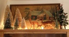 Beautiful lit display of a framed snowy picture, deer and bottle brush trees Christmas Mantels, Christmas Past, Winter Christmas, Christmas Crafts, Christmas Decorations, Woodland Christmas, Rustic Christmas, Vintage Christmas, Snowy Pictures