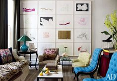 In a Manhattan townhouse designed by Jeffrey Bilhuber, one living room wall is given over to a collection of etchings by German artist Thomas Schütte.  ARCHITECT: Rietveld Architects DESIGNER: Bilhuber and Associates PHOTOGRAPHER: William Waldron