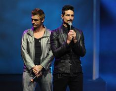 """Nick Carter and Kevin Richardson of The Backstreet Boys perform onstage during Glamorama """"Fashion in a New Light"""" benefiting AIDS Project Los Angeles presented by Macy's Passport at Orpheum Theatre on September 12, 2013 in Los Angeles, California."""
