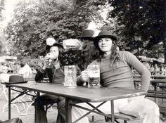 Deep Purple Mk IV: Ian Paice, David Coverdale and Tommy Bolin having some beer at a Munich Biergarten, 1975