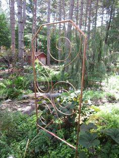 Copper trellis - I wonder how long it would take copper thieves to steal it. Use PVC and copper spray paint instead.