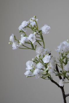 Gypsophilia, a pretty faux stem which delicate looking petals. Ideal for filling out a floral bouquet