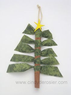 About a week ago, I saw some adorable cinnamon stick tree ornaments made with fabric scraps on the Cosmo Cricket blog. (Click here  to se...