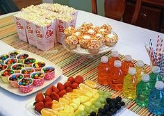 Rainbow party food: M, fruit, cupcakes with rainbow sprinkles, bottled water with a drop of food coloring