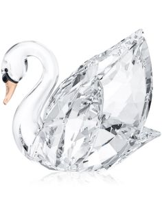 A beautiful tribute to the majesty of nature, Swarovski's Swan collectible figurine is crafted in clear and matte crystal. A beak in Light Peach crystal adds a hint of color to a piece perfect for col