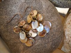 Natural Shell Coin Beads and Antique Brass Dangle Earrings by Beads4You2008 on Etsy https://www.etsy.com/listing/280719692/natural-shell-coin-beads-and-antique