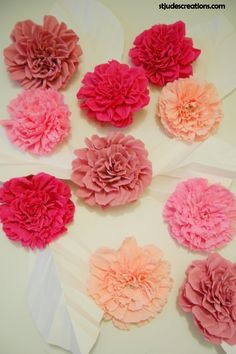 Pink paper flower wedding backdrop.