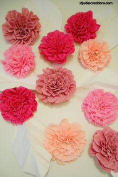 Pink paper flower wedding backdrop.