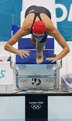 Fran Halsall of Great Britain competes in the Women's 100m Butterfly heats on Day One of the London 2012 Olympic Games at the Aquatics Centre on July 28, 2012 in London, England.