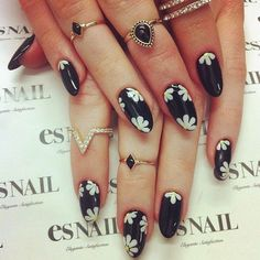 An elegant example how to pair black and white flower nails with jewelry and rings