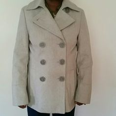 NWOT Calvin Klein grey double breasted wool coat Flattering fishtail detail in the back. Never worn.  All buttons accounted for. Calvin Klein Jackets & Coats Pea Coats