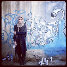 Shamsia Hassani, an Afghan graffiti artist, poses in front of her work in progress. Click-through for a slideshow of photos by Mikhail Galustov, who spent the week photographing Kabul for our Instagram feed: http://nyr.kr/UxQJuI