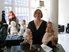 A repin of artist Cynthia Malbon with two of her dolls