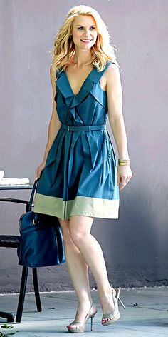 Claire Danes in teal sleeveless belted dress