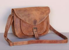 Our new classic leather saddle bag has been lovingly handmade from quality leather using traditional leather crafting skills. #gift #giftideas #christmasgift #adventuregift #adneture #leather #leatherbag