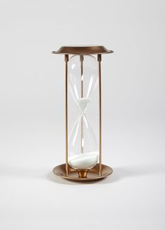 Metal sand timer with a bronze effect. Dimensions: 28cm x 13cm and lasts for 5 minutes.£10
