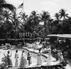 Palm Beach Fashion (© Slim Aarons)  A fashion show by the pool at the New Colony Hotel, Palm Beach, Florida, 1962.