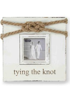 "Distressed painted wood frame features decorative rope knot accent at top and ""tying the knot"" etched sentiment beneath 3"" x 3"" photo opening. Stands with dowel easel or hangs on wall. Perfect for every beach wedding!  Size: 7 1/2"" sq  Tying The Knot Frame by Evelyn Hill. Home & Gifts - Home Decor - Frames New Hampshire"