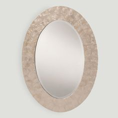With an iridescent shimmer, our oval mother of pearl mirror blends traditional design with contemporary elegance.