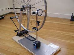 Chuck writes - This article describes how to assemble an inexpensive, but very accurate, wheel building stand for bicycles. The stand uses a dial gauge ind