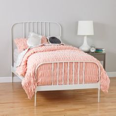 Our Larkin Bed might have a simple design, but that doesn't mean it lacks style. This elegant metal bed features an arched headboard and footboard for a slightly softer look. And it comes in a variety of pastel finishes, adding a nice touch of color to any bedroom.