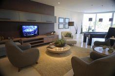 Sala de estar com espaço para jogos
