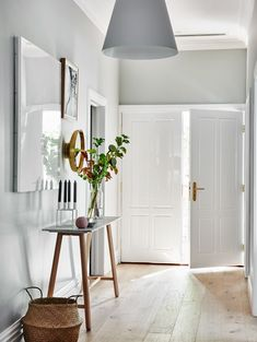 You never get a second chance to make a first impression. Turn your entrance hallway into an area that is welcoming and practical. I have 7 tips here to help you. Scandi Chic, Scandi Home, Scandinavian Home, Scandi Style, Bungalow Interiors, Bungalow Decor, Bungalow Hallway Ideas, Brighten Dark Hallway, Grey And White Hallway