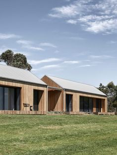 Exterior, Metal Roof Material, Gable RoofLine, Wood Siding Material, and House Building Type The residence is comprised of two rural-style pavilions that are connected and clad in Blackbutt eucalyptus timber. Architecture Agency, Modern Architecture, Modern Barn House, Shed Homes, House Goals, Pavilion, Exterior Design, Bungalow, Building A House