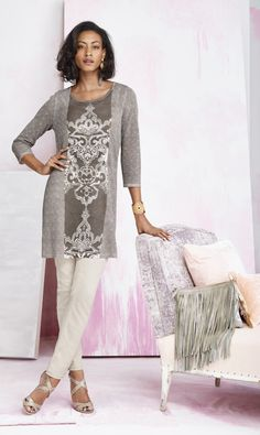 This sweater dazzles with a beaded, scrolled pattern that's perfectly placed.