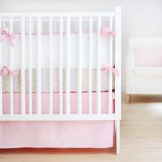 New Arrivals Crib Bedding around $300. Like the idea of solid bedding and colorful sheet.