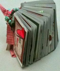 This site has some really cute ideas!!!  All types of mini books and scrapbooks.  Very, very, very cute!
