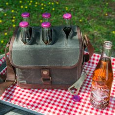 From tailgate to bonfire, be the life of the party with the Bottle Caddy! This cooler can hold six of your favorite bottled beverages and includes a bottle opener that's attached to a retractable cord for easy access to your drink. The insulated walls and padded dividers will keep your beverage cool and protected as you hop from get-together to party.