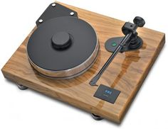 The Pro-Ject Xtension turntable is my choice to replace my ageing Dual CS-721. Czechoslovakian made by one of the recently rising stars in the resurgence of vinyl, this table is a classic with current state-of-the-art construction and materials. And it is beautiful in this optional olive wood lacquered finish.
