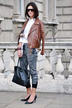 Shop this look on Lookastic:  http://lookastic.com/women/looks/sunglasses-dress-shirt-biker-jacket-bracelet-sweatpants-tote-bag-pumps/8529  — Black Sunglasses  — White Dress Shirt  — Brown Leather Biker Jacket  — Silver Bracelet  — Charcoal Sweatpants  — Black Leather Tote Bag  — Black Leather Pumps