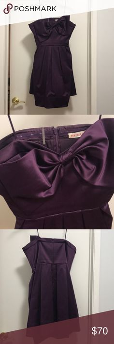 Stunning Aubergine Rebecca Taylor Dress Rebecca Taylor strapless fit and flare dress. Classic girly bow detail. Deep aubergine color. Well taken care of. An incredible dress perfect for a wedding, party, or cocktails. Slight wear under arms as seen in photo.  Hidden back zipper. Rebecca Taylor Dresses Strapless