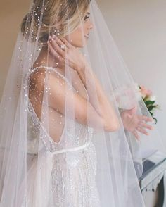 Veil for bride wearing beaded wedding dress