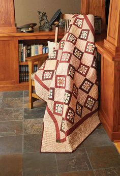 Wars Remembered, by Kathy Munkelwitz, gets its vintage look from Civil War reproduction prints. Dark red frames the star quilt blocks against a scrappy background. This throw quilt pattern will appeal to the traditionalist in you.