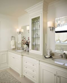 Gorgeous Master Bathroom Features A Light Grey Double Vanity Adorned With Polished Nickel Knobs