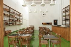 simple and seasonal fare served at a restaurant-deli where chalkboard menus rest on wooden fruit crates, walls are covered in bright white corrugated zinc, and the floors are painted a striking avocado green.